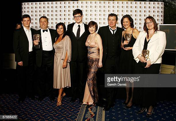 Cast and production team including actors Nigel Harman Jesse Wallace James Alexandrou Kacey Ainsworth and Shane Richie pose in the Awards Room with...
