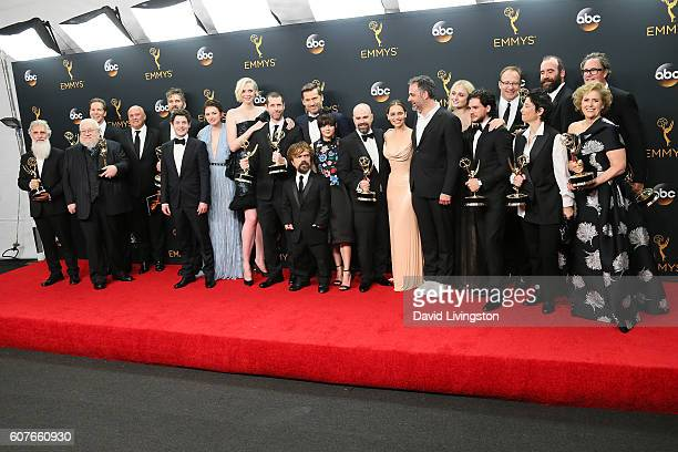 Cast crew of 'Game of Thrones' winner of the Oustanding Drama Series award poses in the 68th Annual Primetime Emmy Awards Press Room at the Microsoft...