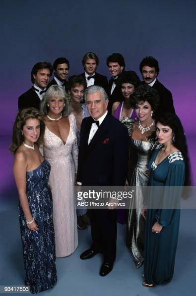 DYNASTY cast gallery Season Four 10/4/83 Pictured back row left John James Michael Nader Al Corley Gordon Thomson Geoffrey Scott middle row Pamela...
