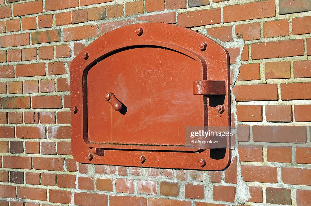 Cast Iron Clean Out Frame And Door For Old Incinerator : Stock Photo