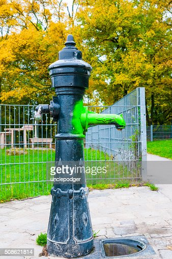 Cast iron water pump in park : Stock Photo