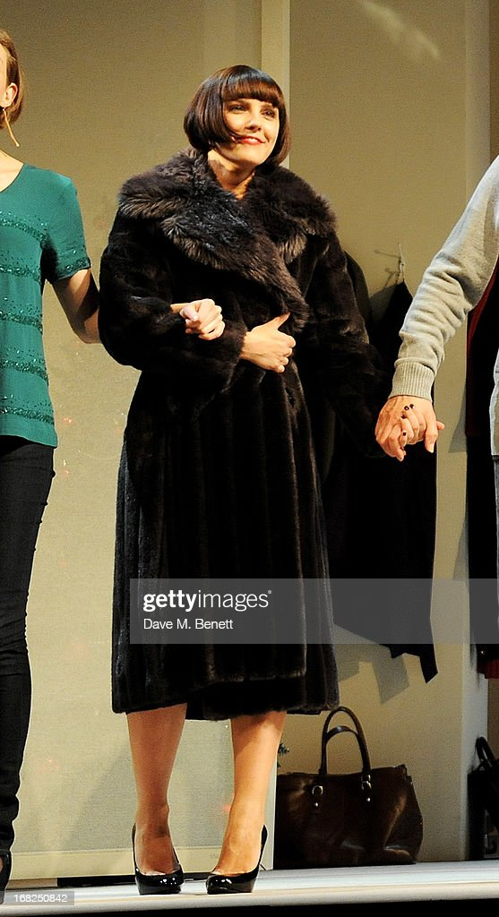 Cast member Annabel Scholey bows at the curtain call during the press night performance of 'Passion Play' at the Duke Of York's Theatre on May 7, 2013 in London, England.