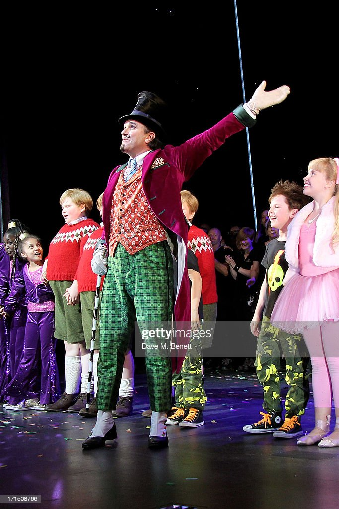 Cast member <a gi-track='captionPersonalityLinkClicked' href=/galleries/search?phrase=Douglas+Hodge&family=editorial&specificpeople=690764 ng-click='$event.stopPropagation()'>Douglas Hodge</a> (C) and cast bow at the curtain call during the press night performance of 'Charlie And The Chocolate Factory' at the Theatre Royal Drury Lane on June 25, 2013 in London, England.