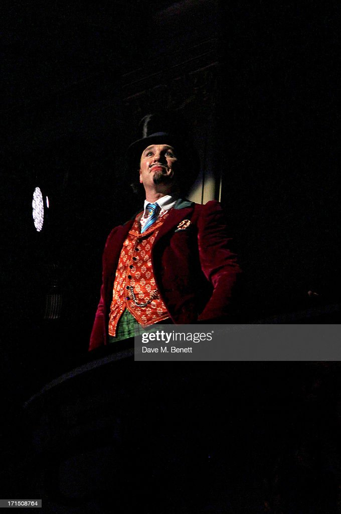Cast member <a gi-track='captionPersonalityLinkClicked' href=/galleries/search?phrase=Douglas+Hodge&family=editorial&specificpeople=690764 ng-click='$event.stopPropagation()'>Douglas Hodge</a> bows at the curtain call during the press night performance of 'Charlie And The Chocolate Factory' at the Theatre Royal Drury Lane on June 25, 2013 in London, England.