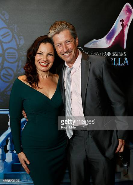 Cast member Fran Drescher and actor Charles Shaughnessy pose during a post show photo op for the opening night performance of 'Rodgers Hammerstein's...