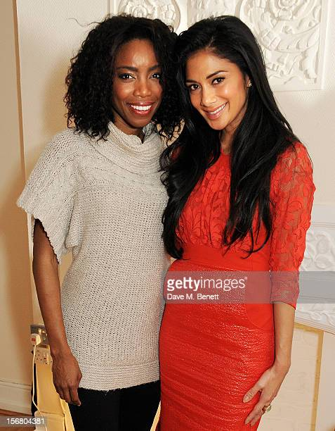 Cast member Heather Headley and Nicole Scherzinger pose backstage at the West End production of 'The Bodyguard' playing at the Adelphi Theatre on...