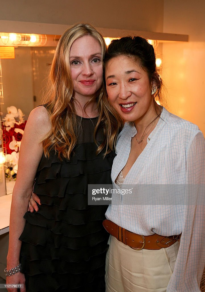 Cast member Hope Davis (L) and actress Sandra Oh (R) pose backstage after the opening night performance of 'God of Carnage' at Center Theatre Group's Ahmanson Theatre on April 13, 2011 in Los Angeles, California.