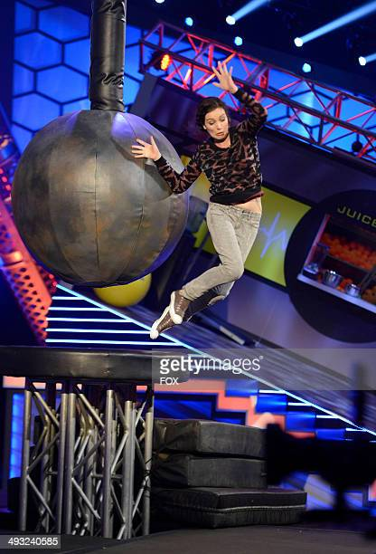 Cast member Jessica McKenna battles the 'Wrecking Ball' in the Jason Alexander and Cheryl Hines episode of RIOT airing Tuesday May 27 2014 on FOX