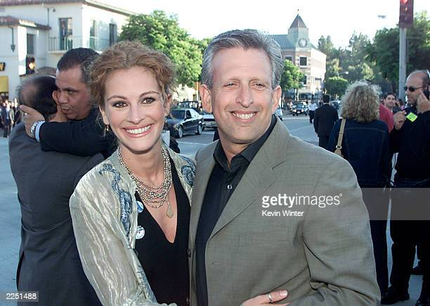 Cast member Julia Roberts and Director Joe Roth arrive for the premiere of the movie 'America's Sweethearts' at the Westwood Mann Bruin Los Angeles...