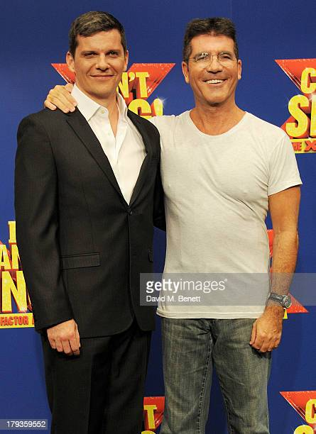 Cast member Nigel Harman and Simon Cowell attend a photocall to launch 'I Can't Sing The X Factor Musical' at RADA on September 2 2013 in London...