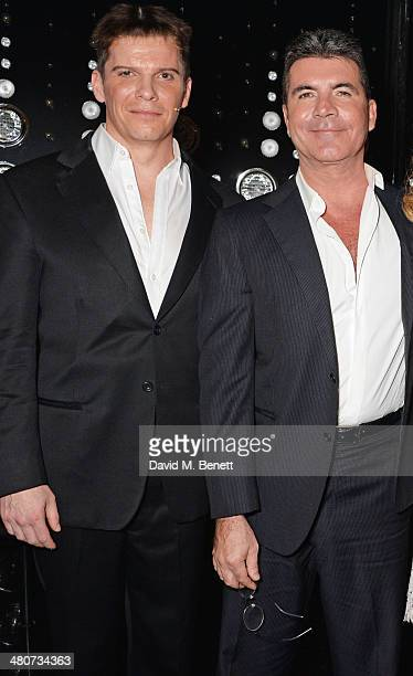 Cast member Nigel Harman and Simon Cowell pose backstage at the press night performance of 'I Can't Sing The X Factor Musical' at the London...