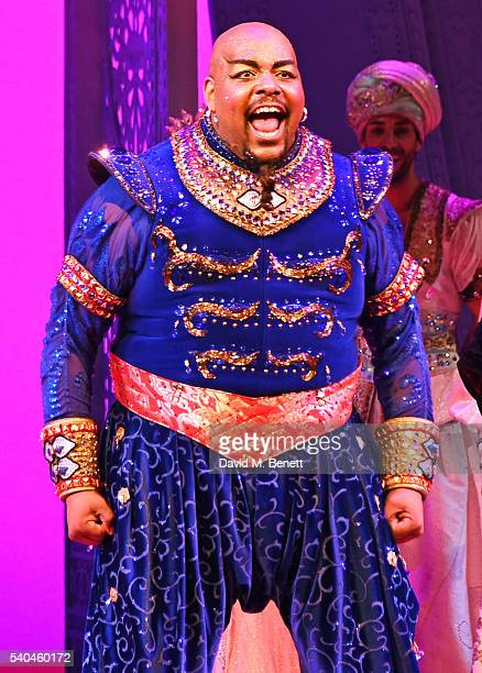 Cast member Trevor Dion Nicholas bows at the curtain call during the press night performance of Disney's 'Aladdin' at The Prince Edward Theatre on...