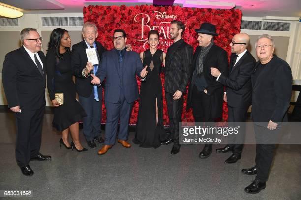 Cast members Bill Condon Audra McDonald Ian McKellen Josh gad Emma Watson Dan Stevens Ewan McGregor Stanley Tucci and Alan Menken pose backstage at...