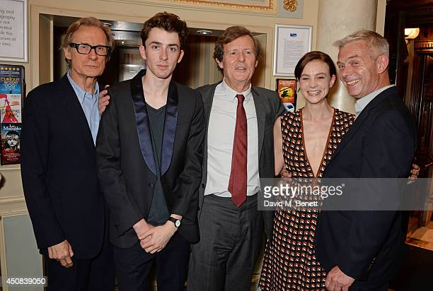 Cast members Bill Nighy and Matthew Beard writer David Hare cast member Carey Mulligan and director Stephen Daldry pose in the foyer following the...