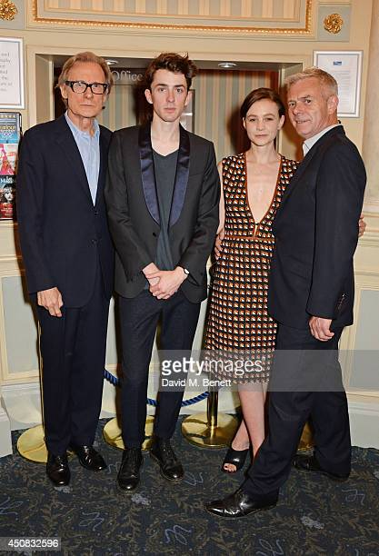 Cast members Bill Nighy Matthew Beard and Carey Mulligan pose with director Stephen Daldry in the foyer following the press night performance of...