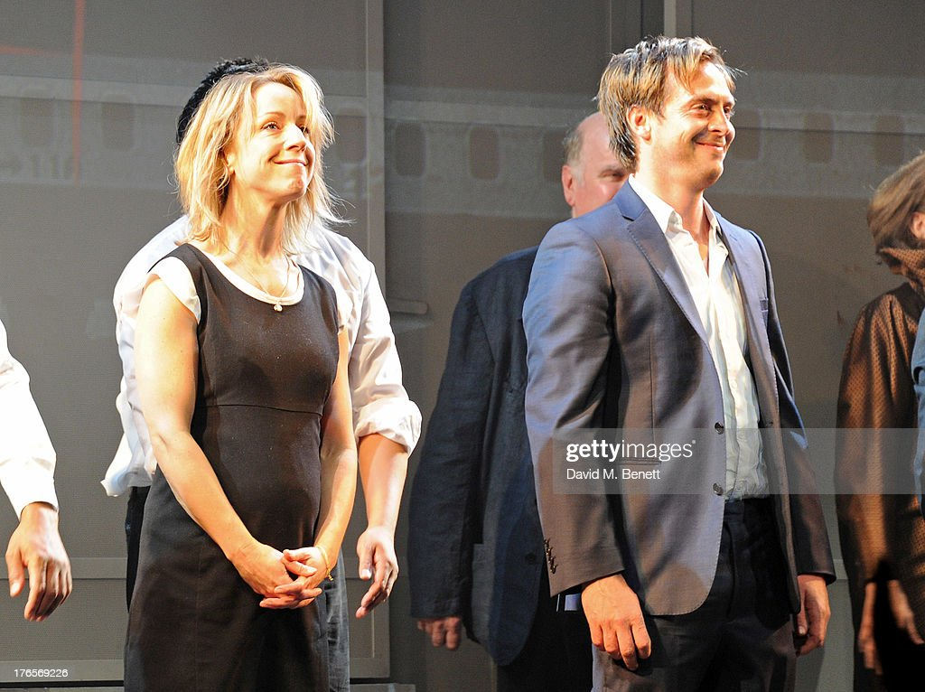 Cast members Claudie Blakley (L) and Stephen Campbell Moore bow at the curtain call during the press night performance of 'Chimerica' at the Harold Pinter Theatre on August 15, 2013 in London, England.