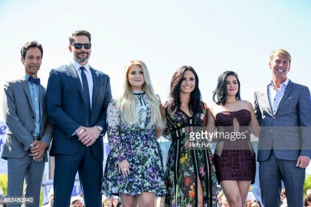 Cast members Danny Pudi Joe Manganiello Meghan Trainor Demi Lovato Ariel Winter and Jack McBrayer arrive at the premiere of Sony Pictures' 'Smurfs...