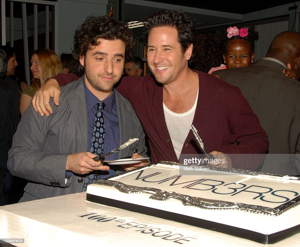 Cast members David Krumholtz and Rob Morrow attend a cakecutting ceremony celebrating 100 episodes of 'Numb3rs' at LA Center Studios on March 25 2009...