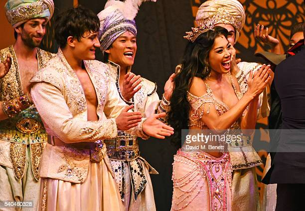 Cast members Dean JohnWilson and Jade Ewen bow at the curtain call during the press night performance of Disney's 'Aladdin' at The Prince Edward...