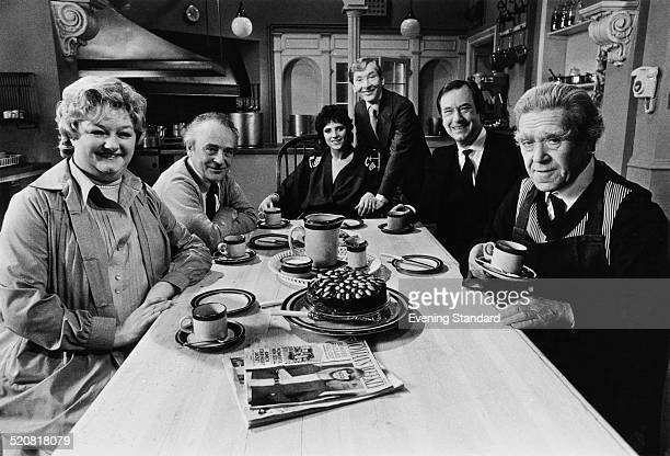 Cast members from 'Carry on Emmannuelle' pose for a photo during a break from filming 18th April 1978 L R English actors Joan Sims Kenneth Connor...