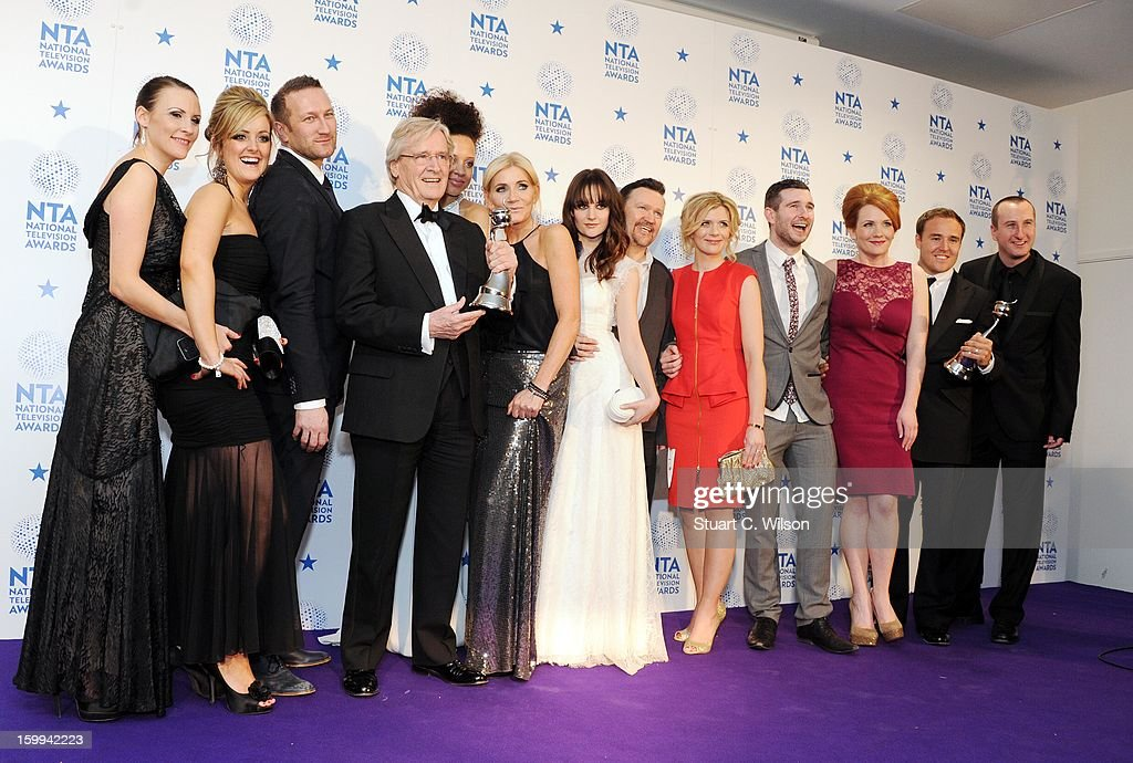 Cast members from 'Coronation Street' pose in the press room at the London Critics' Circle Film Awards at The Mayfair Hotel on January 20, 2013 in London, England.