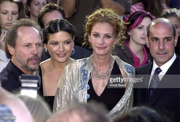 Cast members from left to right Billy Crystal Catherine Zeta Jones Julia Roberts and Stanley Tucci pose at the premiere of 'America''s Sweethearts'...