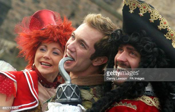 STANDALONE Cast members from Peter Pan on Ice Natalie Cunningham Julien Bouchard and Trevor Buttenham visit Edinburgh castle to promote their world...