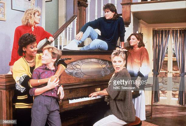 Cast members from the television series 'The Facts of Life' stand around a piano circa 1987 Kim Fields MacKenzie Astin and Cloris Leachman Lisa...