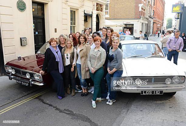 Cast members Gemma Arterton and Isla Blair pose with the ladies of the 'Made In Dagenham' company as they arrive at The Adelphi Theatre on September...