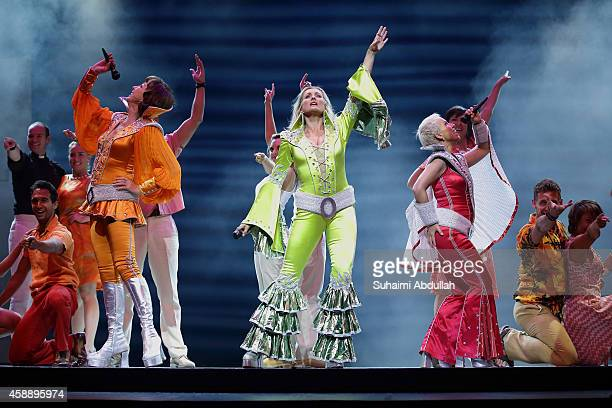 Cast members Geraldine Fitzgerald Sara Poyzer and Sue Devaney of the broadway musical 'Mamma Mia' perform on stage during the media call at the...