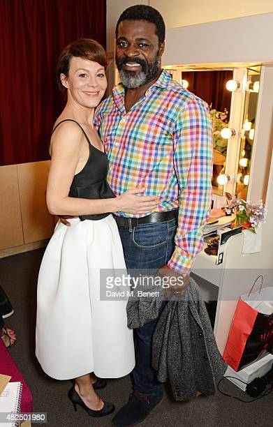 Cast members Helen McCrory and Danny Sapani pose backstage following the press night performance of 'Medea' at The National Theatre on July 21 2014...