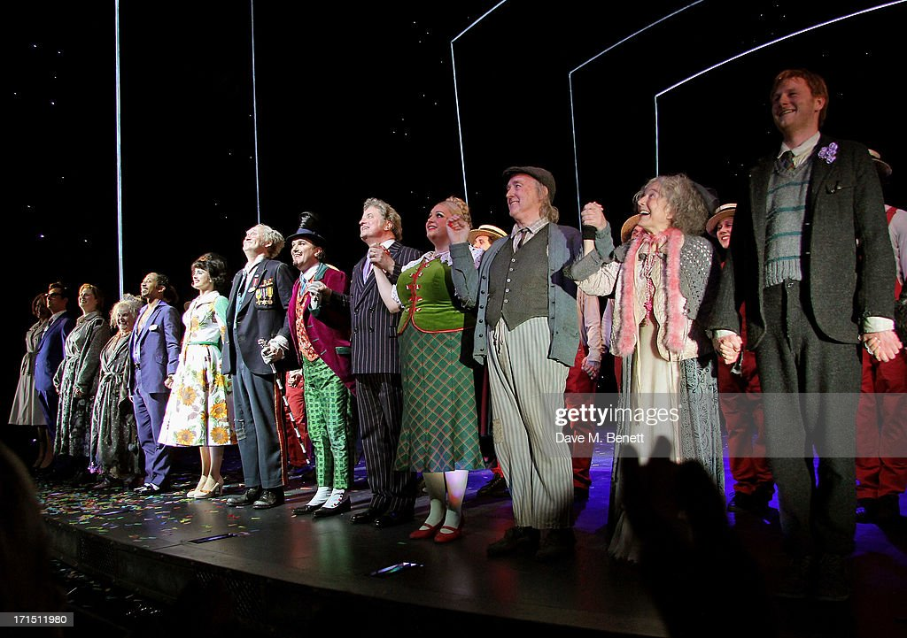 Cast members including Douglas Hodge (7L) and Nigel Planer (6L) bow at the curtain call during the press night performance of 'Charlie And The Chocolate Factory' at the Theatre Royal Drury Lane on June 25, 2013 in London, England.
