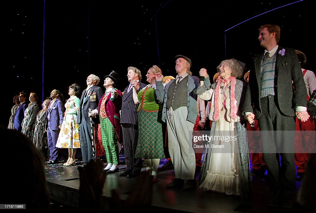 Cast members including Douglas Hodge (8L) and Nigel Planer (7L) bow at the curtain call during the press night performance of 'Charlie And The Chocolate Factory' at the Theatre Royal Drury Lane on June 25, 2013 in London, England.