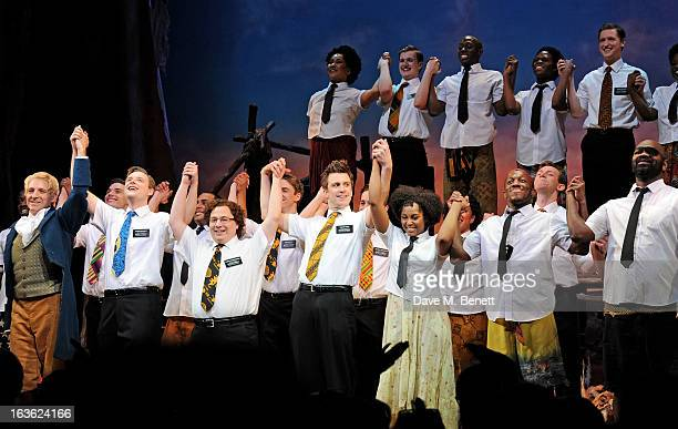 Cast members including Jared Gertner Gavin Creel and Alexia Khadime bow at the curtain call during a gala performance of 'The Book Of Mormon' in aid...