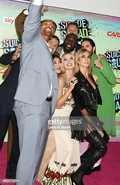 Cast members including Jay Hernandez Will Smith Karen Fukuhara Adewale AkinnuoyeAgbaje Margot Robbie Jai Courtney Jared Leto and Cara Delevingne pose...