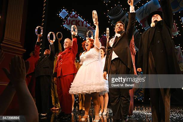 Cast members including Rebel Wilson and Simon Lipkin bow at the curtain call during the press night performance of the acclaimed West End production...