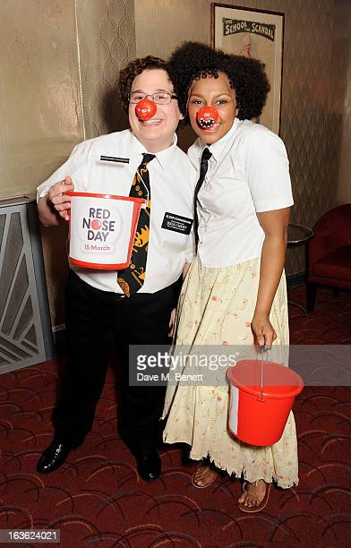 Cast members Jared Gertner and Alexia Khadime collect donations at a gala performance of 'The Book Of Mormon' in aid of Red Nose Day at the Prince Of...