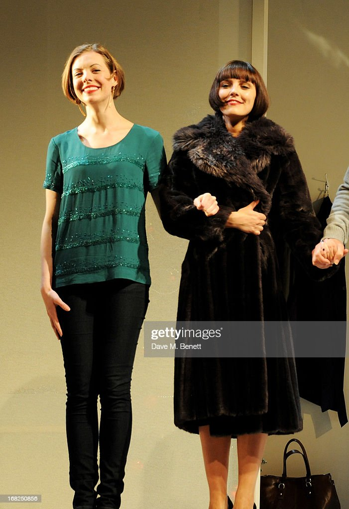 Cast members Kelly Burke (L) and Annabel Scholey bow at the curtain call during the press night performance of 'Passion Play' at the Duke Of York's Theatre on May 7, 2013 in London, England.