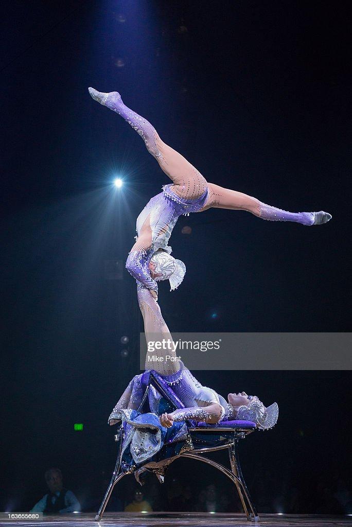 Cast members Marina Tsodikova and Svetlana Tsodikova perform in 'Cirque Du Soleil's Totem' Dress Rehearsal at Citi Field on March 13 2013 in New York...