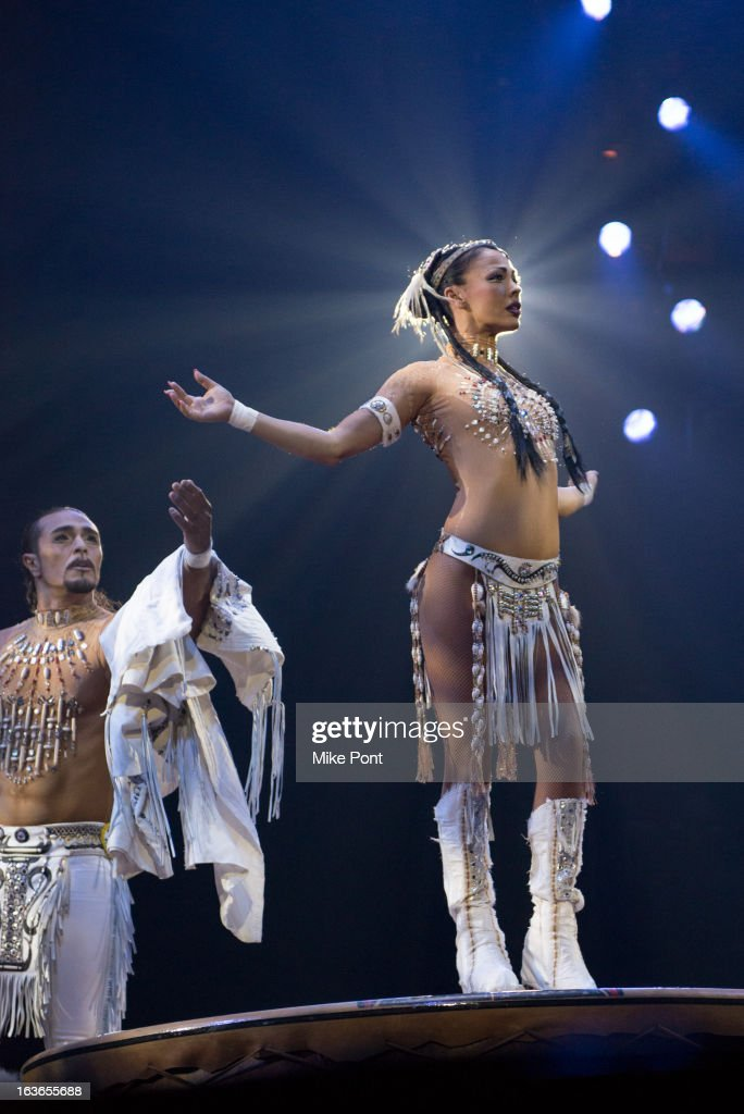 Cast members Massimilano Medini and Denise GarciaSorta perform in 'Cirque Du Soleil's Totem' Dress Rehearsal at Citi Field on March 13 2013 in New...