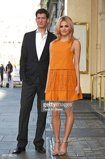 Cast members Matt Barber and Pixie Lott pose at a photocall for a new stage adaptation of Truman Capote's 'Breakfast at Tiffany's' at the Theatre...