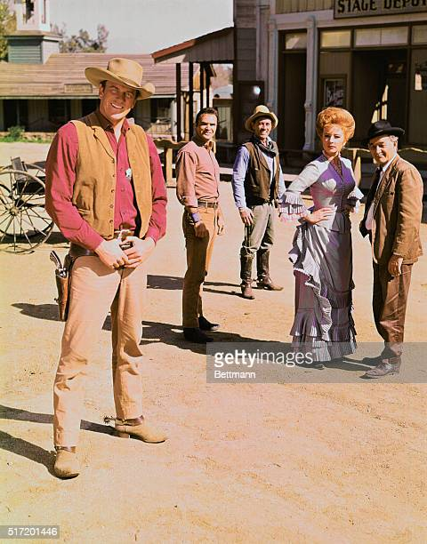 Cast members of Gunsmoke including James Arness as Marshal Matt Dillon Burt Reynolds as Quint Asper Ken Curtis as Deputy Festus Haggen Amanda Blake...