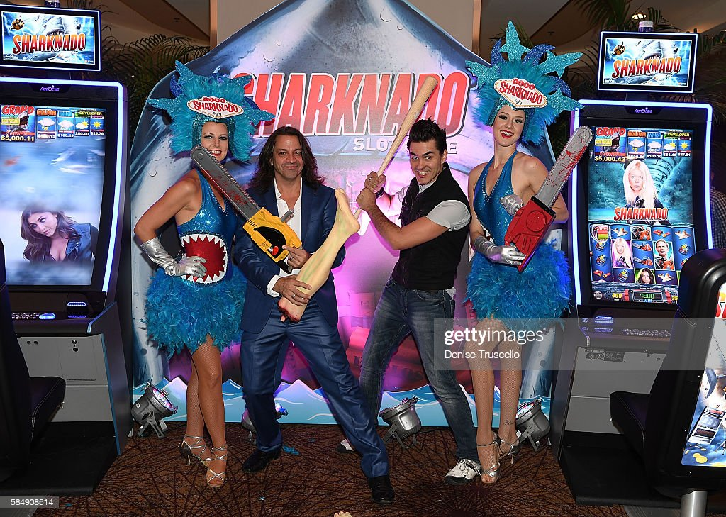 Cast members of Rock of Ages appear with Sharknado the newest casino slot game from Aristocrat 'Sharknado The 4th Awakens' made its world premiere in...