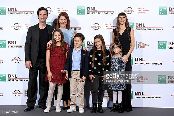 Cast members of the movie attend a photocall for 'Sole Cuore Amore' during the 11th Rome Film Festival at Auditorium Parco Della Musica on October 15...