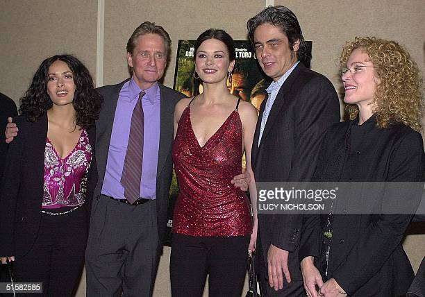 Cast members of the new film 'Traffic' pose at the film's premiere in Beverly Hills CA 14 December 2000 Mexican actress Salma Hayek US actor Michael...