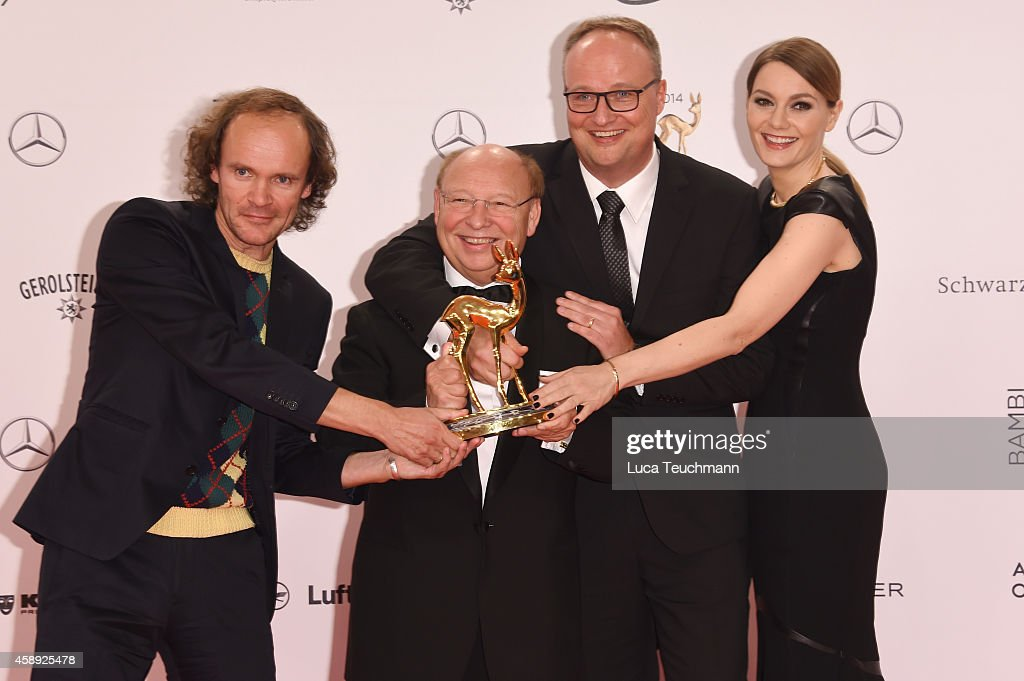 Cast members of the tv show 'heute show', (L-R) Olaf Schubert, Hans-Joachim Heist, Oliver Welke and Martina Hill, pose with their award during Kryolan at the Bambi Awards 2014 on November 13, 2014 in Berlin, Germany.
