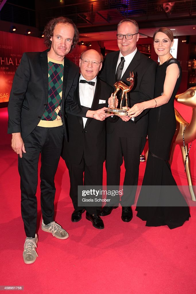 Cast members of the tv show 'heute show', (L-R) Olaf Schubert, Hans-Joachim Heist, Oliver Welke and Martina Hill pose with their award during Kryolan at the Bambi Awards 2014 on November 13, 2014 in Berlin, Germany.