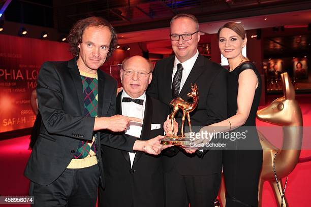 Cast members of the tv show 'heute show' Olaf Schubert HansJoachim Heist Oliver Welke and Martina Hill pose with their award during Kryolan at the...