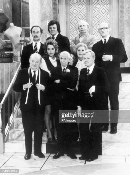 Cast members on set during filming of the BBC sitcom 'Are You Being Served' Frank Thornton Trevor Bannister Arthur English and Nicholas Smith Wendy...