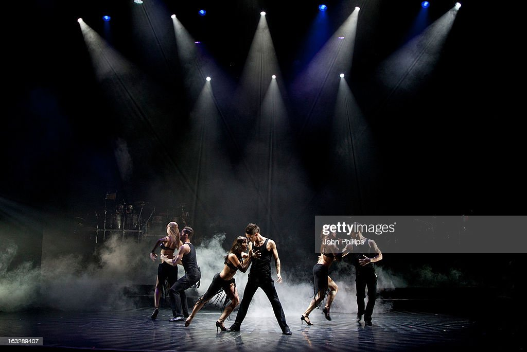Cast members perform during a photocall for 'Burn The Floor' at Shaftesbury Theatre on March 7, 2013 in London, England.